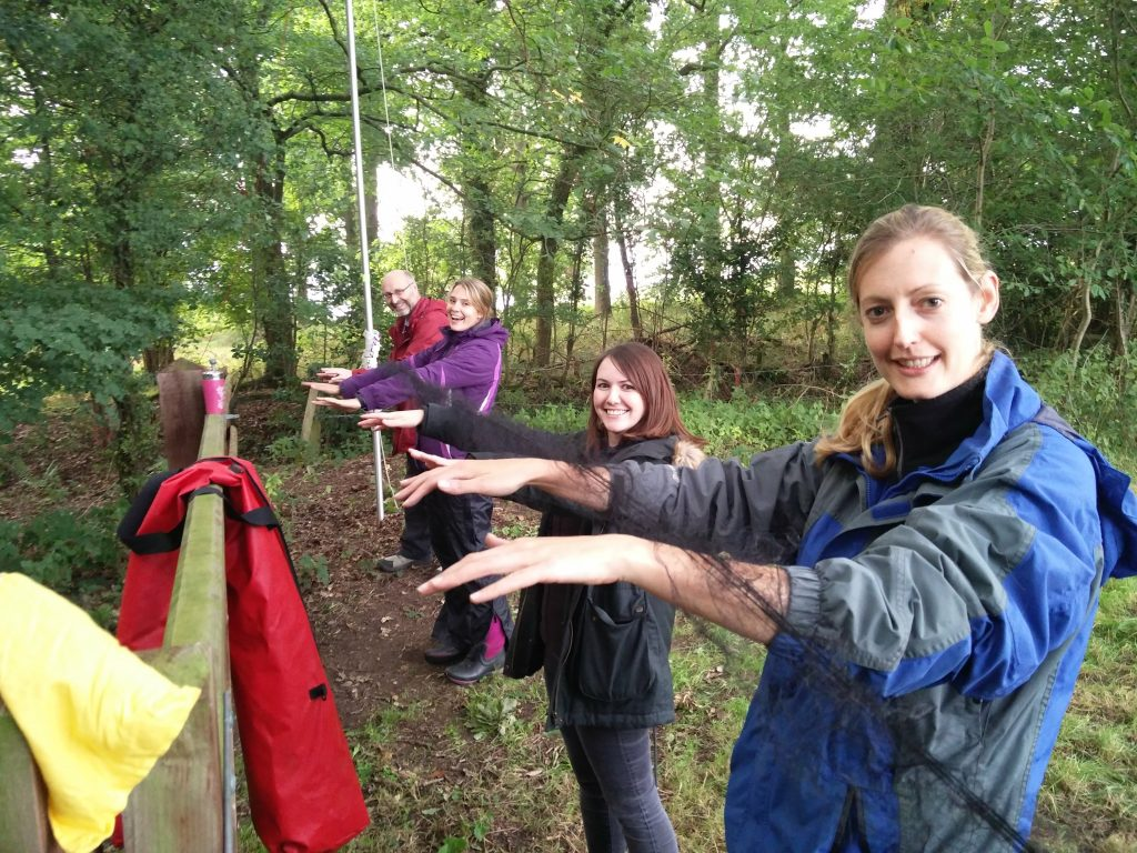 Trainees holding nets on a training course